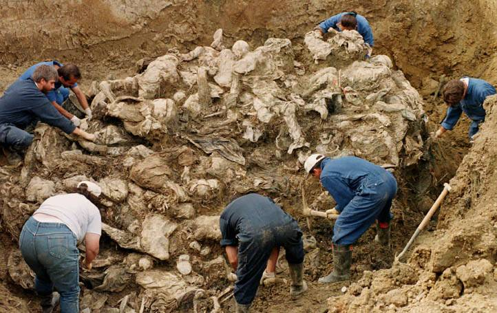 Postmodern memento mori - inspectors of the UN checking a mass grave after the Balkan wars.