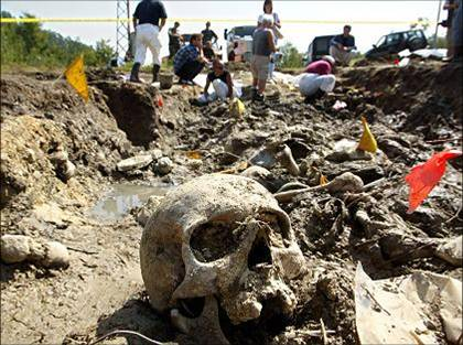 Postmodern memento mori - a skull in a recently exhumed mass grave.