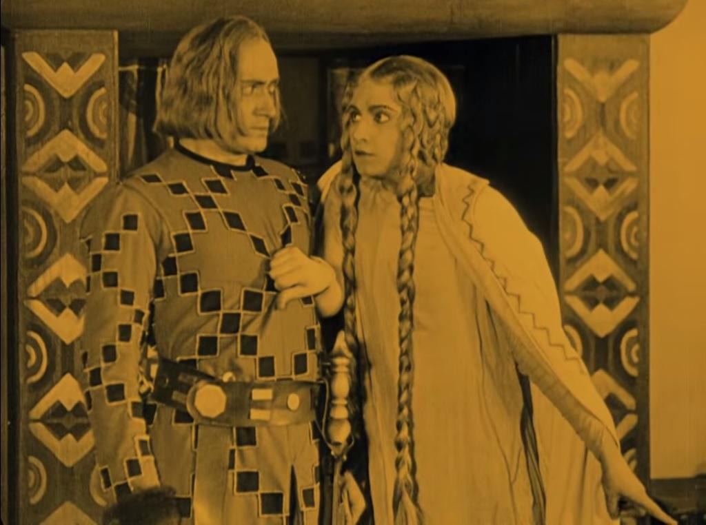 1.29: A viszonylag kicsiny mélységű tér dinamikus texturális és kompozicionális mintázatokat teremt (végiga képkeret sarkáig): Kriemhild a meggyilkolt férjre mutat Fritz Lang <em>A Nibelungok II.: Kriemhilda bosszúja</em> (<em>Die Nibelungen: Kriemhilds Rache</em> 1924) című filmjében.